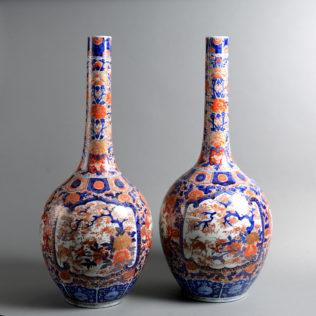 A Tall Pair of 19th Century Imari Bottle Vases