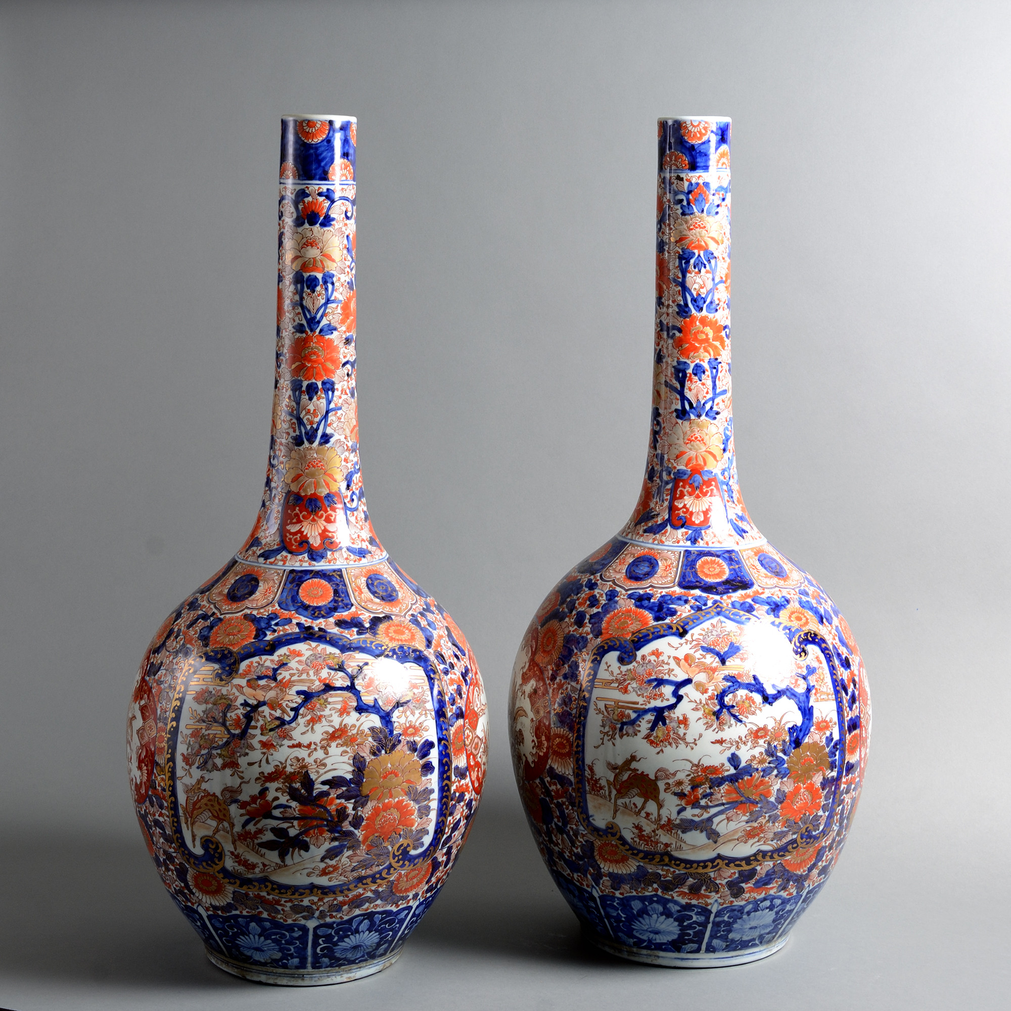 A Tall Pair of 19th Century Imari Bottle Vases