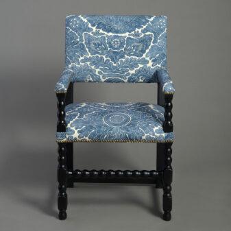 Pair of Ebonised armchairs
