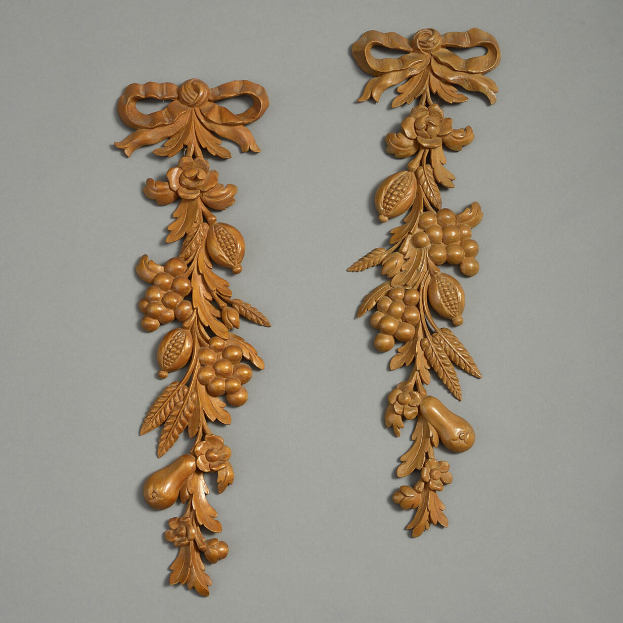 Pair of Carved Wooden Drops